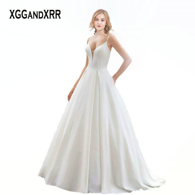 XGGandXRR Romantic Ball Gown Satin Wedding Dress 2019 Sexy V Neck Spaghetti Straps Sheer Back Long Bridal Gown with Buttons