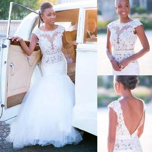 Image 1 - 繊細なチュール自然なウエストラインマーメイドウェディングドレスとレースのアップリケビーズシースルーブライダルドレス