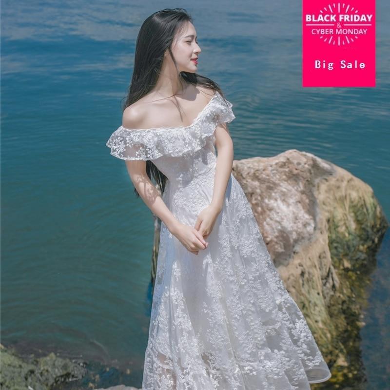 2019 été nouveau mode puere blanc à volants avec licou robe crochet fleurs creux coupe dentelle robe grande balançoire robe wj317