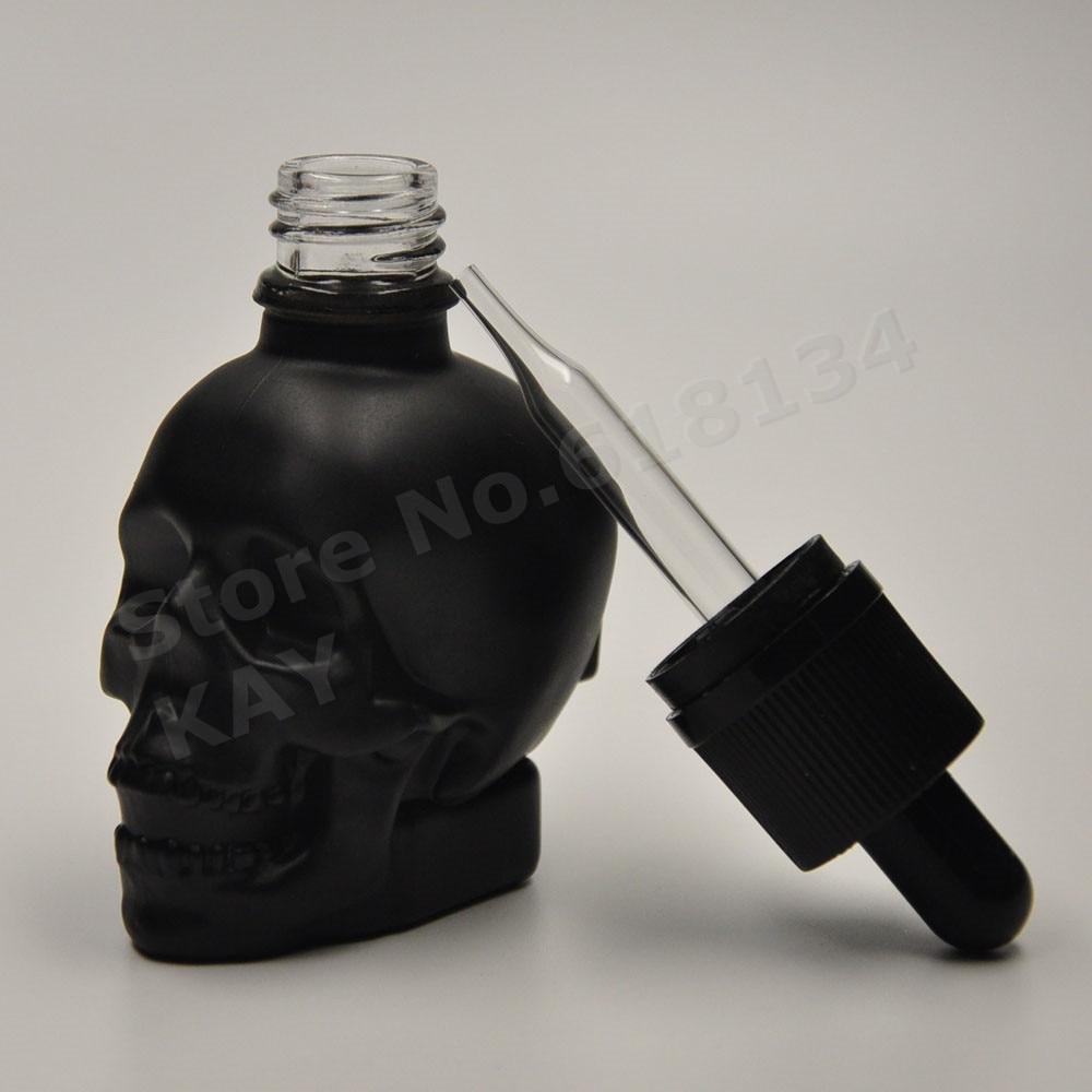 Livraison gratuite 30 ml crâne gouttes bouteille en verre noir matériel bouteille 100 PCS