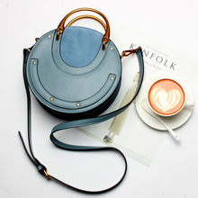 Womens fashion leather retro metal portable small round bag Europe and rivet
