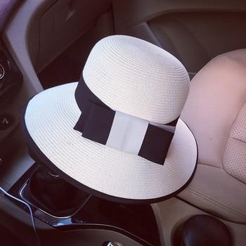 FGHGF 1920 s estilo de las mujeres sombrero de paja de verano cinta arco  Bowler Cloche cubo sombrero de sol de la Iglesia Derby té Amplia playa sombrero  de ... 8b9ff4d4670