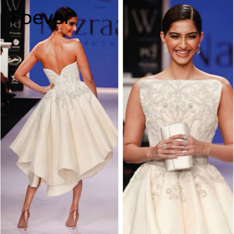 Bollywood Actress sonam Kapoor dressed Embroided Evening dress during the India International Jewelry Week
