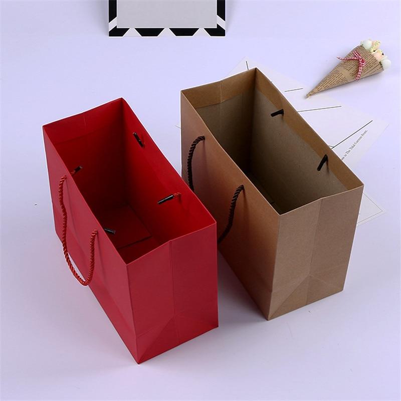 100 unids/lote Kraft bolsa de regalo de papel con mango 25x11,3x19 cm boda cumpleaños fiesta regalo de Navidad nuevo bolsas para compras de año-in Suministros de envoltorios y bolsas de regalo from Hogar y Mascotas    2