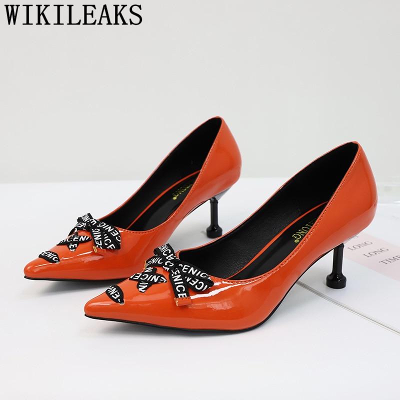 orange and black pumps