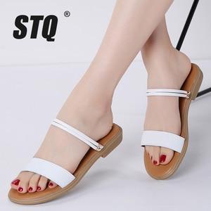 Image 1 - STQ 2020 sandales plates en cuir véritable dété, lanières de cheville, babioles blanches pour dames, 722