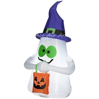 Internal lights inflatable halloween ghost wearing witches hat and holding a bag inflated by a free fan