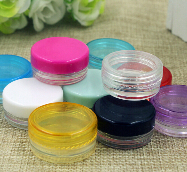 100pcs/lot 2g Small Round s&le Cream Bottle Jars container Mini plastic container for nail & 100pcs/lot 2g Small Round sample Cream Bottle Jars container Mini ...