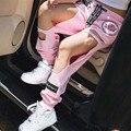 Diseñador de las mujeres a estrenar pink negro ripped stretch moda hip hop pantalones casuales patchwork agujero pantalón de danza pantalones de las muchachas