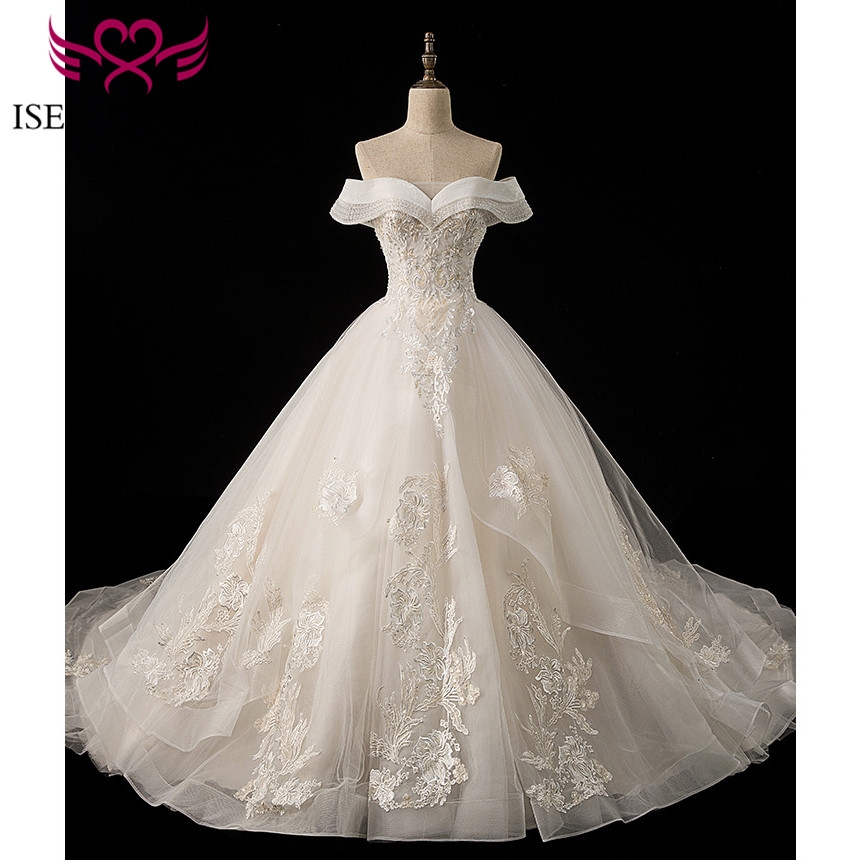 Unique Cap Sleeves Luxury Delicate Embroidery Pearls Beading And Sequined Lace Up Champagne Bridal Dresses Chapel Train WX0024