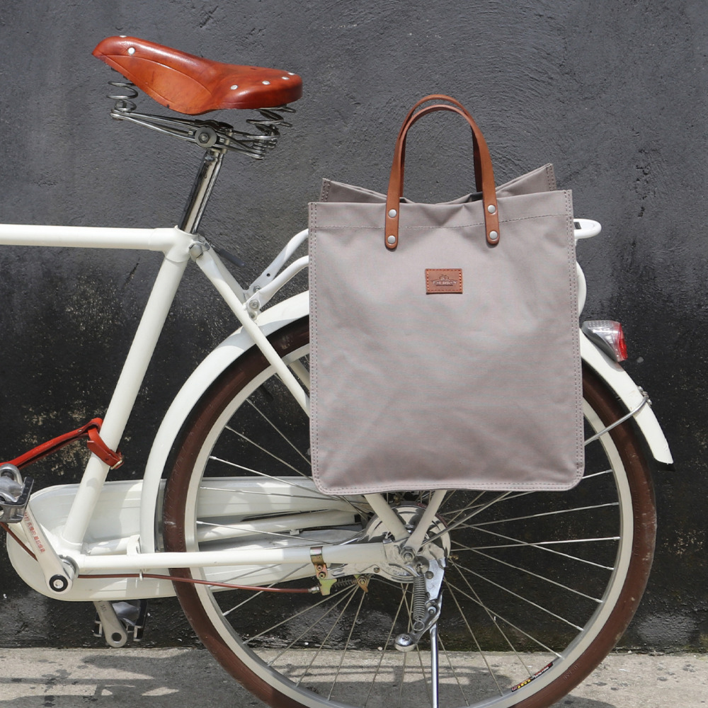 цена на Tourbon Retro Bicycle Pannier Pouch Bike Rear Seat Carrier Bag Grey Cycling Parts Canvas Shopping Bags Pack Hook Attach