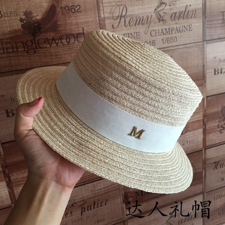 Verano nuevo sombrero de paja plano de lino para mujer elegante letras de  oro británico 0b1ddc7cc4d
