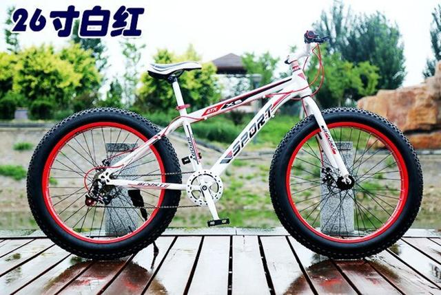 Beach bicycle MTB mountain bicycle 26*4.0 Tires Disc brakes Snow bicycle 7 speed ,fat bikes Carbon Steel