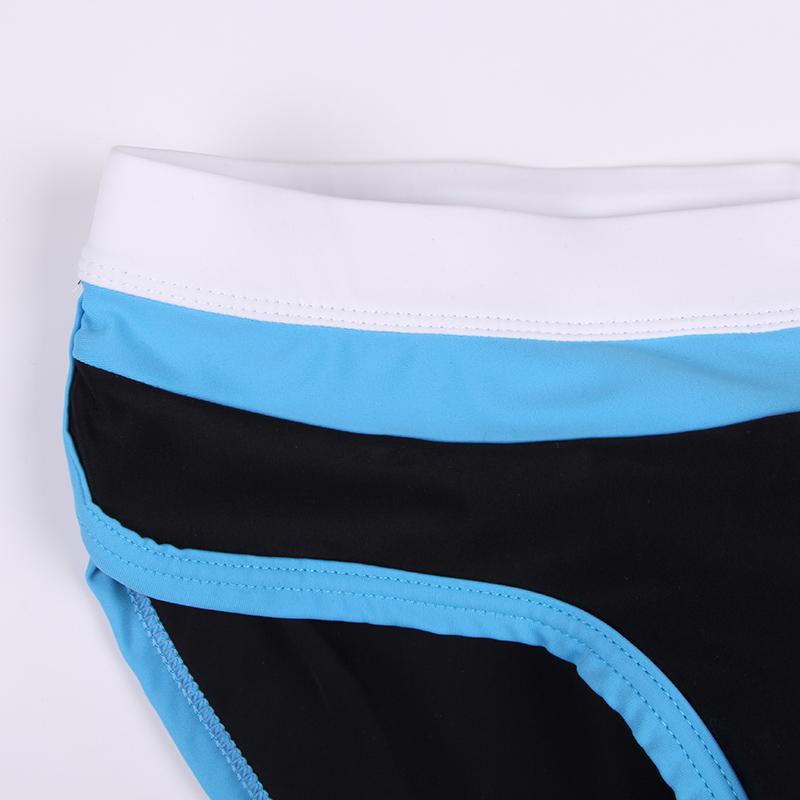 Topdudes.com - Push Up Pachwork Swimming Trunks