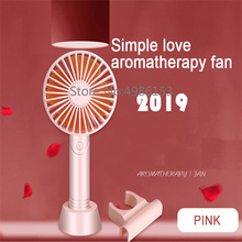 2019 new handheld electric portable fan placed aromatherapy USB mini summer cooling three speeds can be placed mobile phone fan
