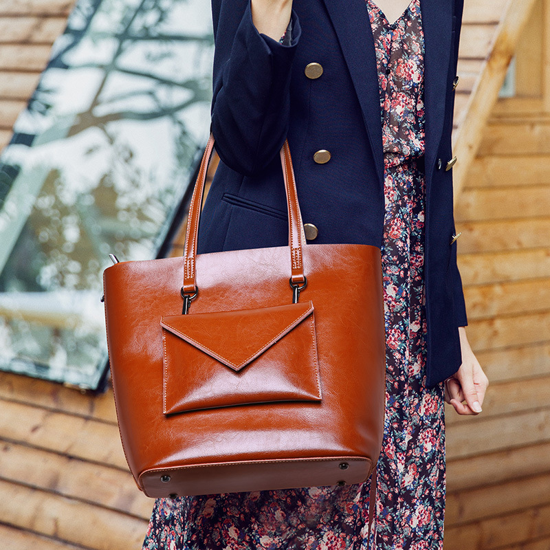 Fashionable luxury oil wax cowhide large capacity bucket design tote bag exquisite sewing line decoration women leather handbags fashionable women s tote bag with cover and pu leather design