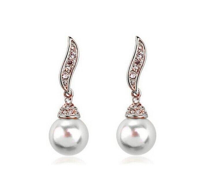 5965ea6318e0 OMH al por mayor comprar 5 pair off20 % de plata oro 18kt cristales  austríacos de oro blanco de la manera hojas en forma perlas cuelgan  Pendientes eh156