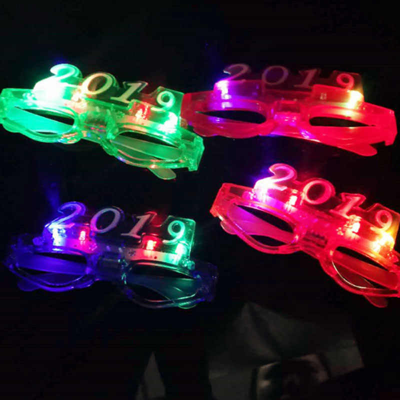 bc7757ec8d8 ... 12pcs lotCreative Christmas New Year 2019 LED Light Glasses Party Ball  Eye Wear Funny Novelty