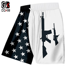 OGKB Summer Cool Short Pants Man Hiphop Quick Dry Polyester Toursers Men's Cool Print American Flag And Gun Beach Board Shorts(China)