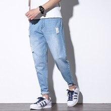 2018 moda Harem Ripped Jeans hombres primavera verano Denim Pantalones  Casual Hip Hop Streetwear Mens Jeans 09ba46e13f4