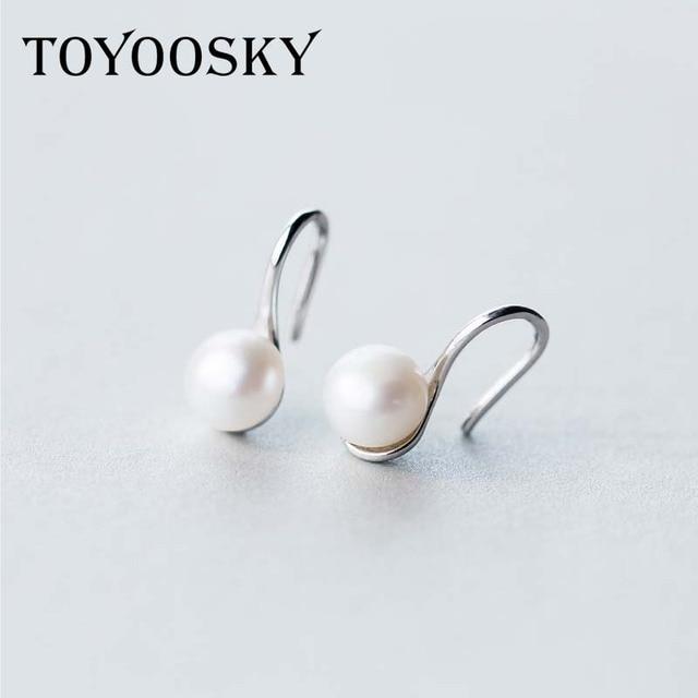 Earrings in Pearl on sterling silver hooks yjRA8w