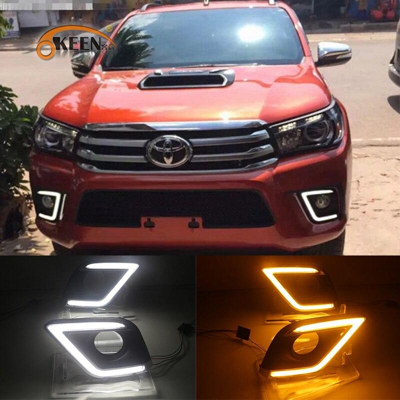 все цены на OKEEN 2pcs Car LED Daytime Running Light for Toyota Hilux Revo Vigo 2015 2016 2017 DRL White Amber Turn Signal Light Fog Lamp