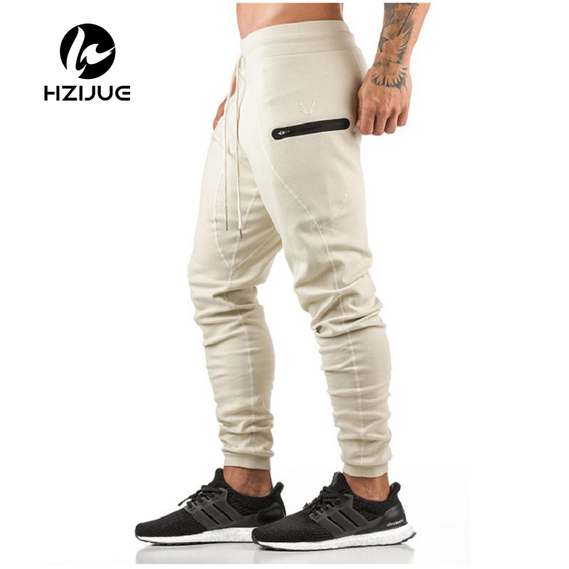 HZIJUE 2018 New Gyms Mens Joggers Skinny Sweat Pants Embroidery Tights Sweatpants For Men Side Zipper Sheer Trouser pant