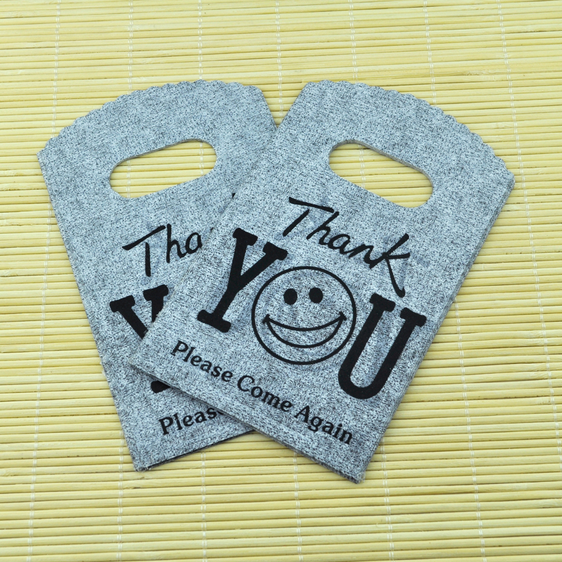 9*15CM 150pcs/lot Gray Smile Face small plastic bag jewelry gift packaging bag cute plastic gift bags shopping bags with handle