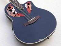 Стоковая овационная модель акустической гитары
