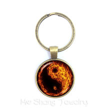 Vintage Yin Yang Keychains Black White Cross Pendant Tai Ji Jewelry Glass Cabochon Keyring Yin Yang Women Men Gifts(China)