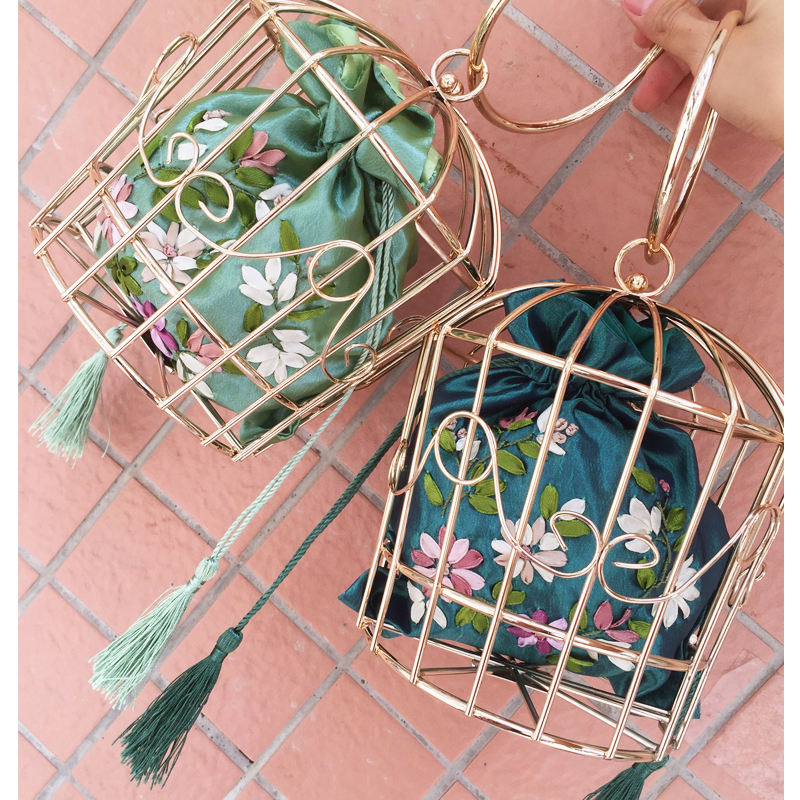 New  personalized fashion hollow metal cage designed satin fringed handbags even