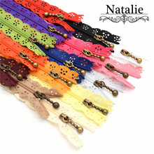 Здесь можно купить  Wholesale Free Shipping 20CM Hollow  Lace Zipper for sewing Antique Bronze puller  10pcs/lot flower novelty mixed color