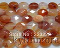8SE09734a 12x16mm Carnelian faceted oval Beads