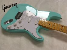 цена на Electric guitar/Gwarem st guitar/green color/guitar in china