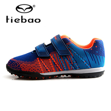 цена на TIEBAO Futbol TF Turf Football Boots Boys Girls Sneakers Soccer Shoes Rubber Soles Breathable Knit Soccer Boots Sport Sneakers
