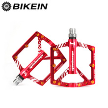 цена на BIKEIN - Professional Cycling Bicycle MTB Pedal 4 Bearing BMX Sealed Pedals Foot Pegs Aluminum CNC Mountain Bike Parts 4 Colors