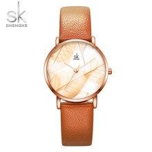 fc495b64bf Shengke nuevo relojes de mujer creativo hojas Dial brillante correa de  cuero reloj de cuarzo de moda de Corea. Señoras reloj Mon.