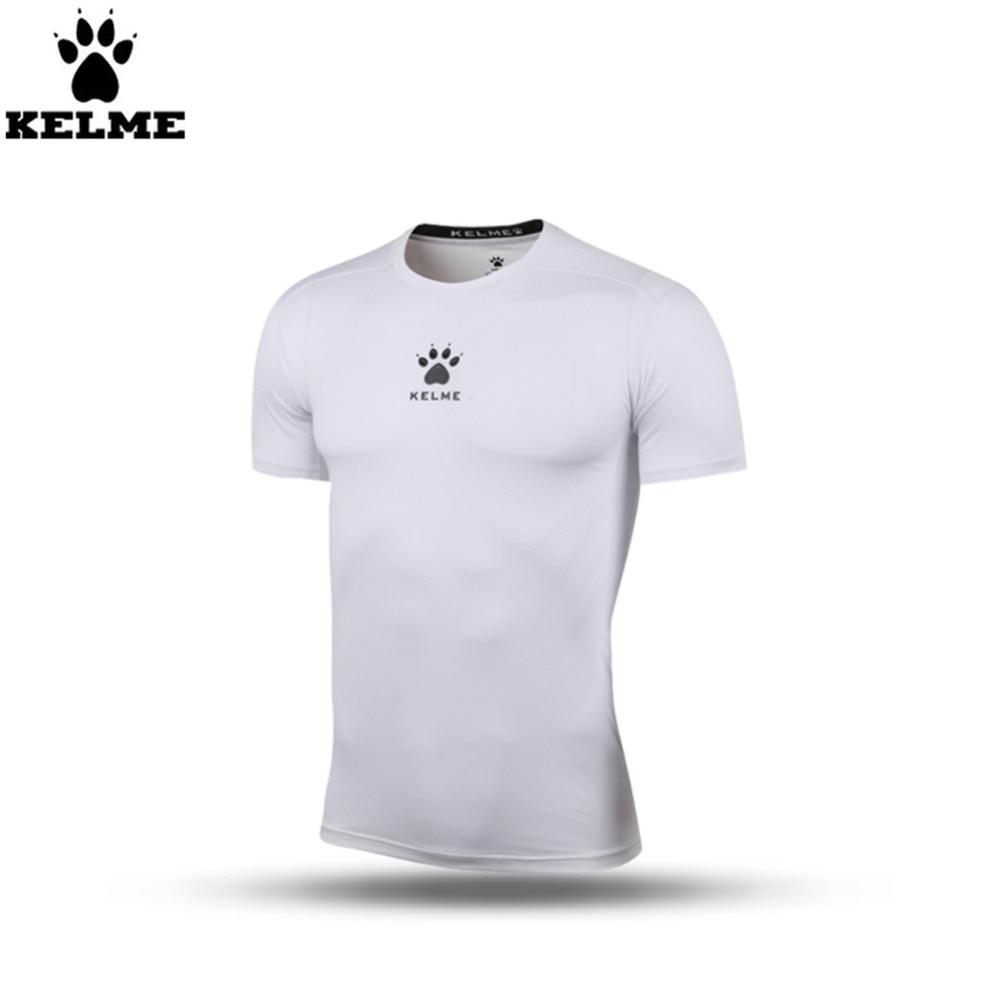 Kelme K15Z731 hombres blanco pro manga corta delgada camisa de fuerza en  Camisetas de fútbol de Deportes y ocio en AliExpress.com  d5320fe968177