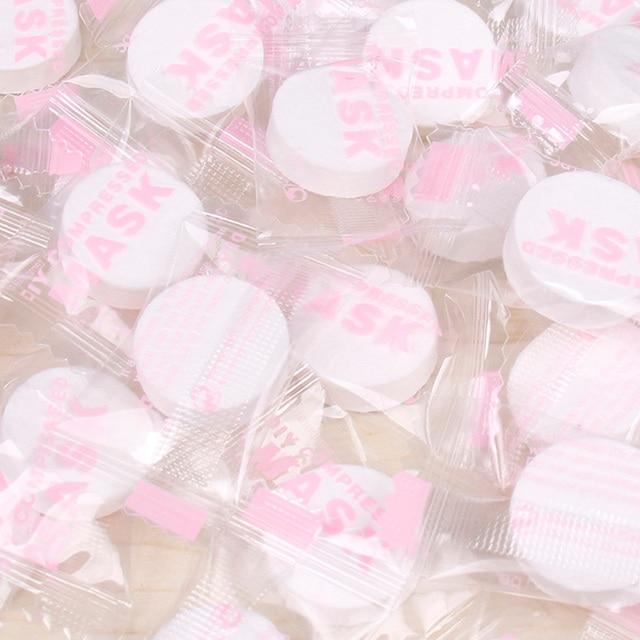50 pz/pacco Naturale Compresso Facciale Maschera di Bellezza Delle Donne Usa E Getta FAI DA TE Viso Maschere di Cotone Maschera di Carta Strumento di Cura Della Pelle
