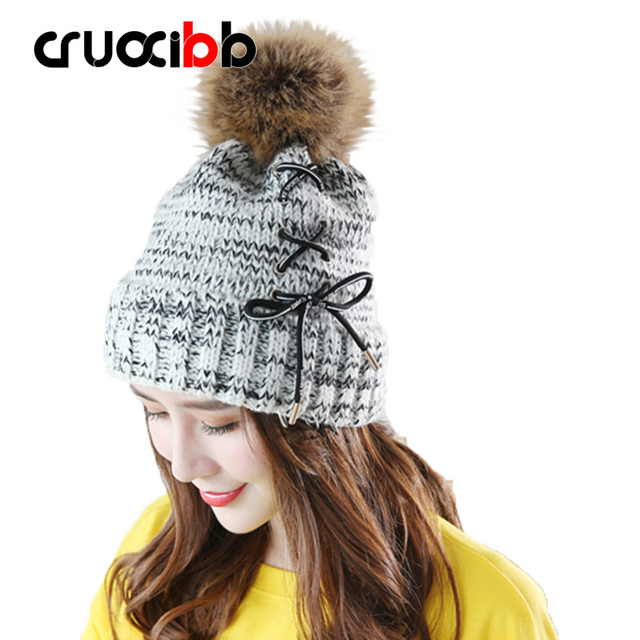 a75e4783b0d4c2 Winter Hat Women Beanie Girls Pom Poms Hats with Large Raccoon Hair Ball  Tie Rope Bow Knitted Rings Super Quality Snow Caps
