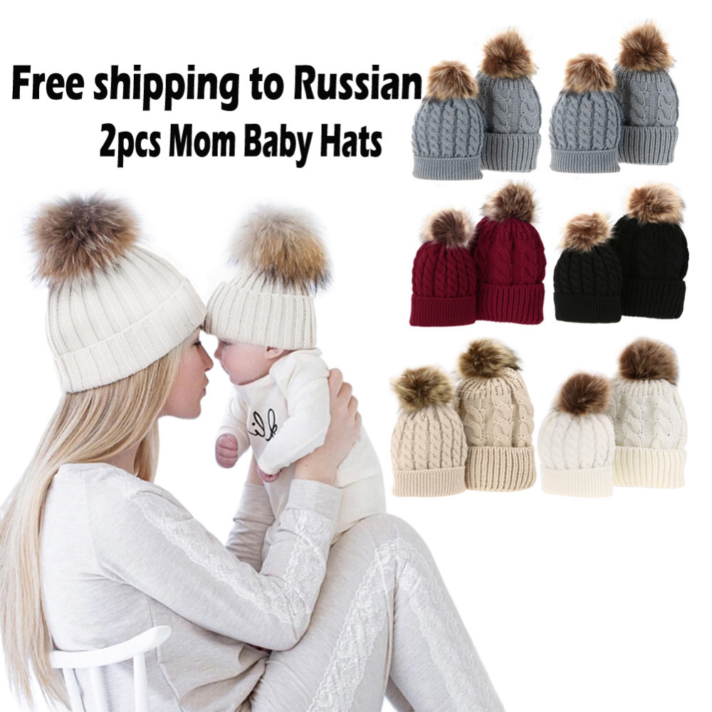 a3a8141ea0b8 2 PCS Winter Hats for Kids Mom Baby Kid Warm Raccoon Fur Beanie Cotton  Knitted Parent-child Pom pom Baby Winter Hat Pompom Cap