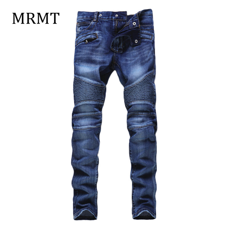 2018 new The new trend of mens offbeat stitching international big hole worn nightclub metrosexual man jeans