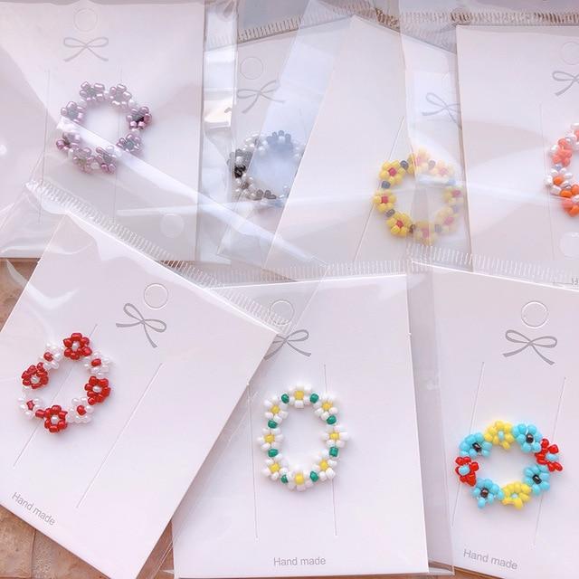 HZ 2019 Colorful Resin Flower Elastic Weaving  Fashion Finger Rings Korea Fashion Hit Color Beads Handmade Rings for Women Girls