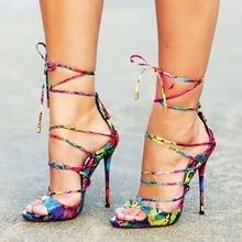 купить Snake Skin Crisscross Tied Sandals Open Toe Thin High Heel Narrow Strap Flower Pattern Shoes Runway Flawless Woman Sexy Shoes по цене 5203.13 рублей
