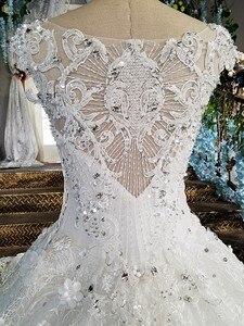 Image 4 - LS00158 vestido de noiva durchsichtig zurück appliques kappen hülsen spitze ballkleid sicke spitze Luxus brautkleider echt fotos