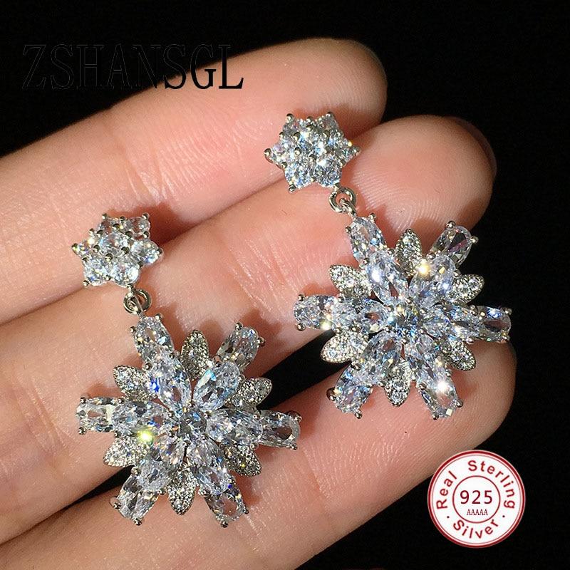 81d32278cd92 Venta caliente romántico flor de nieve pendientes para boda elegante de  Plata de Ley 925 AAA Cubic Zirconia piedra pendiente de la joyería