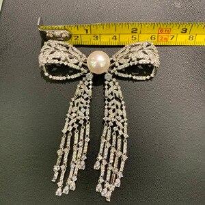 Image 4 - 11 12 ミリメートル天然淡水真珠のブローチ銅立方ジルコンちょうブローチピンタッセル古典的なファッション女性ジュエリー