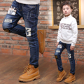 2017 spring and autumn fashion classic children's jeans boy label tf-by letter 3 hole wild children's pants
