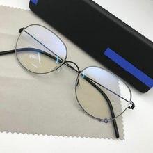 Monturas de gafas de titanio ovaladas para hombre, monturas de gafas de titanio, sin tornillos, miopía, lente clara de Anteojos