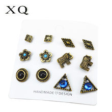 XQ fashion ladies earrings set antique copper flower triangle elephant animal zinc alloy jewelry for men and women punk(China)